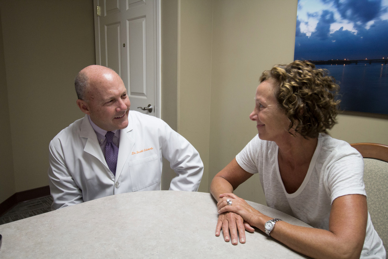 Dr. Edwards talking to a patient